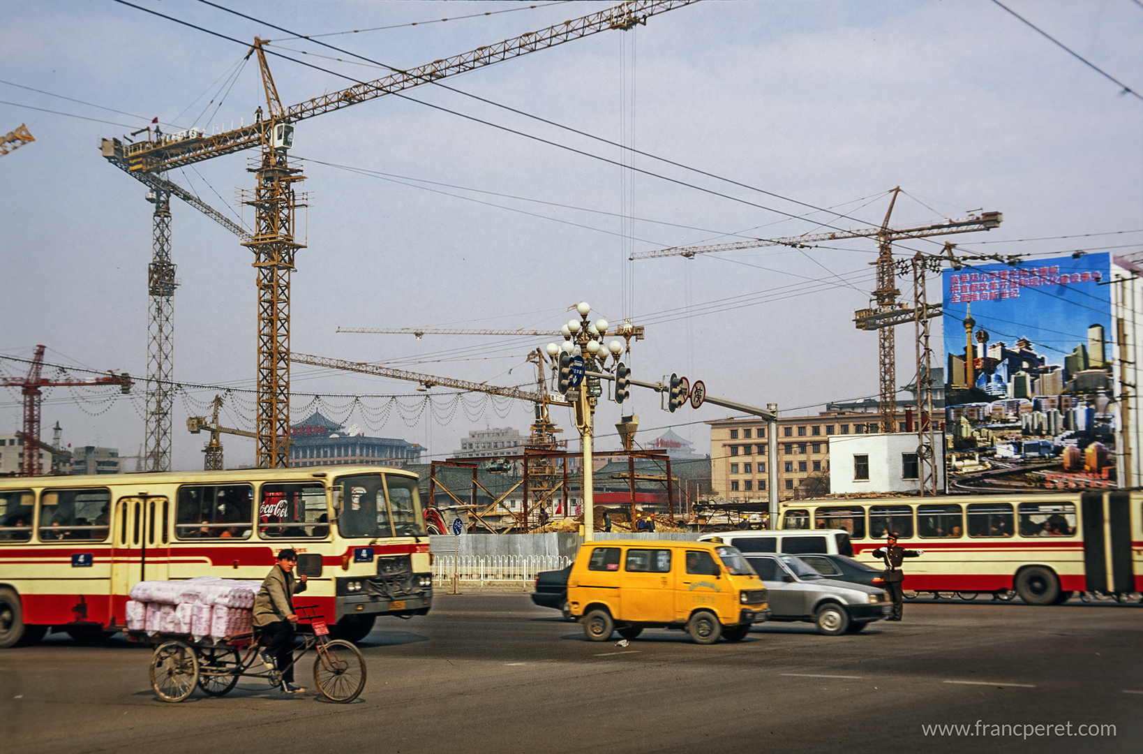 More cranes in the sky than cars in the street during Beijing lifting.