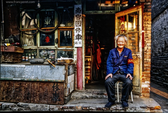 Traditional Beijing Convenient store and bicycle repair shop with its happy owner. Last smile before destruction.
