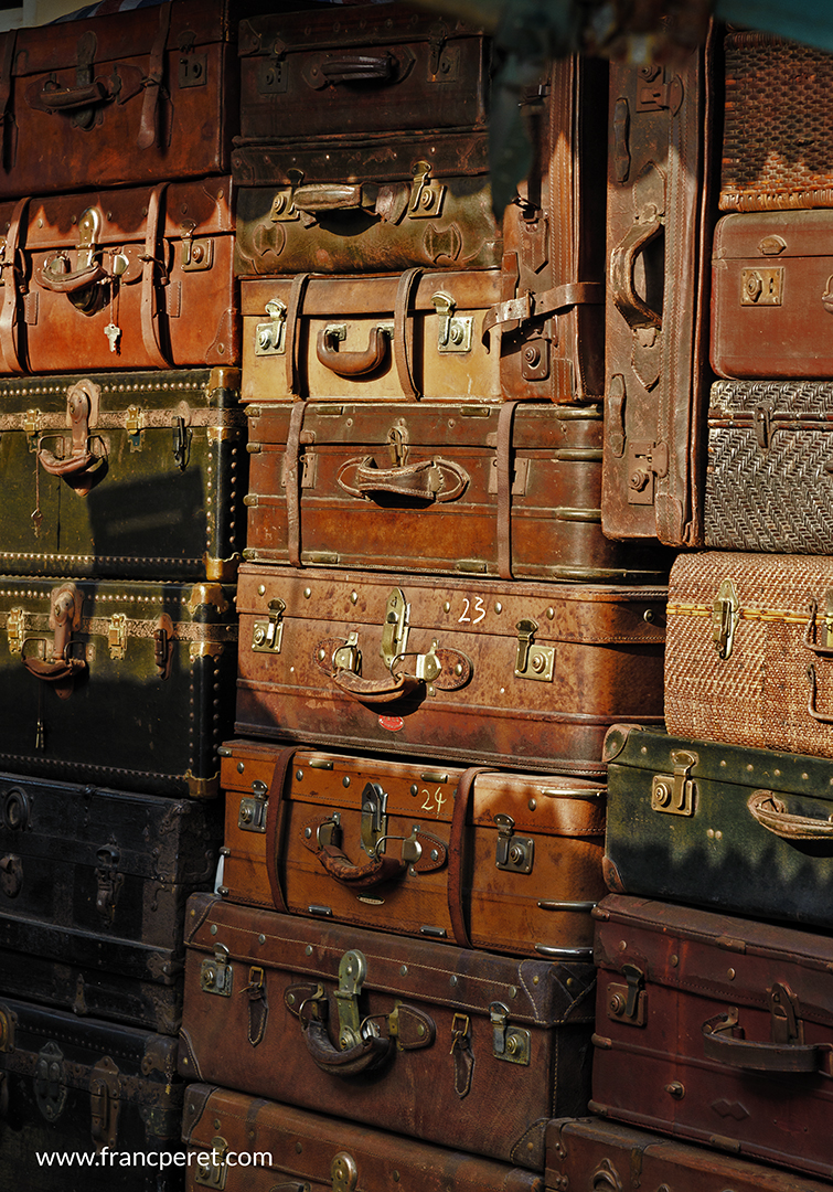 Vintage Suitcase in market. Direct sunlight emphasize colors. details and texture. Nikon D750 ISO200 1/125s with 24-120 mm f/4 @ f/11